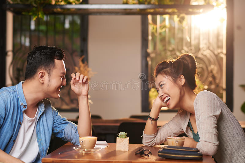 laughing-couple-date-cafe-side-view-portrait-asian-enjoying-94861521